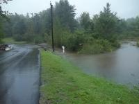 Cox Pond flowing over Pond Road