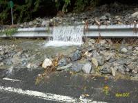 Water, debris on Route 2
