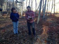Trip leader Brain Yellen displaying fine sediments along nature trail